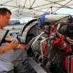 Oklahoma City police officer Jimmy Parsons checks the spark plugs on his boat