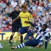 West Bromwich Albion's Stephane Sessegnon battles for the ball with Sunderland's Ki Sung Yeung during the English Premier League match at The Hawthorns, West Bromwich, England, Saturday Sept. 21, 2013. (AP Photo/ PA, Martin Rickett)UNITED KINGDOM OUT  NO SALES  NO ARCHIVE