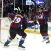 Colorado Avalanche center Nathan MacKinnon, left, celebrates with teammate Paul Stastny after his goal against the San Jose Sharks in the first period of an NHL hockey game on Saturday, March 29, 2014, in Denver. (AP Photo/David Zalubowski)