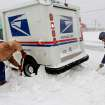 Russell Henderson noticed postal worker George Staros needed some help getting out of a snow drift on Douglas Blvd. near SE 15th Street. Henderson attached a chain from his truck to the mail truck and then helped dig snow from beneath the tires of Staros' vehicle. Within ten minutes, the two men had freed the vehicle and Staros continued with his mail delivery duties. A winter storm created whiteout conditions and caused snow drifts that made problems for the few motorists who ventured out Tuesday morning, Feb. 1, 2011.   Photo by Jim Beckel, The Oklahoman