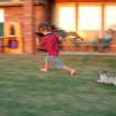 Landon Smith and Penny the Pug take a lap around the yard.  Community Photo By:  Harolda Gibson  Submitted By:  Harolda, Norman