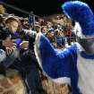 Dakota Johnson, The Guthrie Bluejay, high-fives children in the stands  during a high school football game between Guthrie and East Central at The Rock in Guthrie, Friday, Nov. 18, 2011.  Photo by Garett Fisbeck, The Oklahoman