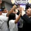 FILE - In this March 6, 2012, file photo, Gavin Maloof, right, co-owner of the Sacramento Kings, celebrates with Kings fans after the Sacramento City Council approved a plan to help finance a new arena, in Sacramento, Calif.  After backing out of the deal to build a new arena in Sacramento and announcing the sale of the Kings to a group that wants to move the team to Seattle, the Maloof brothers have become the city's most-reviled villains heading into a preliminary NBA meeting on the issue Wednesday, April 3, 2013, in New York. (AP Photo/Rich Pedroncelli, File)