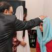 In this photo provided by the Queen Elizabeth Hospital Birmingham, Pakistan's President Asif Ali Zardari, left, and his daughter Asifa Bhutto, center back, meet with Malala Yousufzai, where she is undergoing treatment for injuries sustained when a Taliban gunman opened fire on her and her friends outside the Khushal School for Girls in Mingora, Swat Valley, Pakistan, at the Queen Elizabeth Hospital in Birmingham, England, Saturday, Dec. 8, 2012. The Taliban targeted Malala because of her outspoken and relentless objection to the group's regressive interpretation of Islam that keeps women at home and bars girls from school. (AP Photo/Queen Elizabeth Hospital Birmingham)