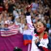 U.S. gymnast Gabby Douglas waves to the crowd after winning gold in the individual all-around in London on Thursday. Douglas is the fourth American gymnast to win the gold medal in the women's all-around. Los Angeles Times/MCT photo