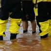 Water rescue crews with the Oklahoma City Fire Department stand in flood water during a rescue effort. Torrential rain caused flooding in Oklahoma City, Monday, June 14, 2010.     by Jim Beckel, The Oklahoman