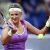 Belarus' Victoria Azarenka hits a forehand against German Mona Barthel during their quarterfinal match at the Porsche tennis Grand Prix in Stuttgart, Germany, Friday, April 27, 2012. (AP Photo/Michael Probst) ORG XMIT: PSTU110