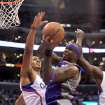 Los Angeles Clippers center Ryan Hollins, left, and forward Lamar Odom, right, defend as Phoenix Suns center Jermaine O'Neal tries to put up a shot in the first half of an NBA basketball game in Los Angeles on Wednesday, April  3, 2013. (AP Photo/Richard Hartog)