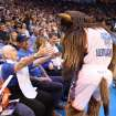 Leola Boyd meets Rumble the Bison at the OKC Thunder's home opener on Friday, Nov. 2 in Chesapeake Energy Arena in Oklahoma City, Okla.      A generous, anonymous Thunder fan provided Leola courtside seats for the game.       Here's the story from the evening from Berry Tramel.