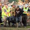 A group of unidentified emergency volunteers move a body recovered among the devastation in Smithville, Mississippi after a tornado destroyed much of the small town on Wednesday, April 27, 2011.(AP Photo/The Northeast Mississippi Daily Journal, C. Todd Sherman)
