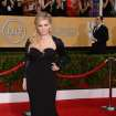 Abigail Breslin arrives at the 20th annual Screen Actors Guild Awards at the Shrine Auditorium on Saturday, Jan. 18, 2014, in Los Angeles. (Photo by Jordan Strauss/Invision/AP)
