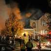 Firefighters work the scene where an explosion has killed two people and damaged more than a dozen homes in the Richmond Hill subdivision, late Saturday, Nov. 10, 2012, in Indianapolis. (AP Photo/The Indianapolis Star, Matt Kryger)