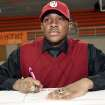 NATIONAL SIGNING DAY / SIGN / SIGNED / LETTER-OF-INTENT SIGNING DAY / OU: Dominique Alexander, who signed his letter of intent to attend the University of Oklahoma, signs with others from Booker T. Washington High School, inside the Nathan E. Harris Field House at Booker T. Washington High School, on National Signing Day, Wednesday, Feb. 6, 2013. CORY YOUNG/Tulsa World ORG XMIT: DTI1302061713086296