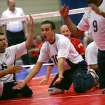 Brazil's Renato de Oliveira Leite (center) celebrates a point with teammates including Deivission Ladeira dos Santos (left) during the fourth day of competition at the World Sitting Volleyball championships on the University of Central Oklahoma campus in Edmond, Okla., on Wednesday, July 14, 2010. Photo by John Clanton, The Oklahoman