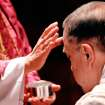 Right Rev. Steven Charleston traces a cross with ashes on a man's forehead during  Ash Wednesday service at St. Paul's Episcopal Cathedral in downtown Oklahoma City  on Wednesday,  Feb 22,  2012. Charleston is interim dean at the cathedral.  Photo by Jim Beckel, The Oklahoman