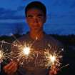 My nephew, Evan Mathew, holds three sparklers on the 4th of July.  Community Photo By:  Cindi Tennison  Submitted By:  Cindi , Bethany