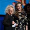 Carole King, left, and Sara Bareilles presents the award for song of the year at the 56th annual Grammy Awards at Staples Center on Sunday, Jan. 26, 2014, in Los Angeles. (Photo by Matt Sayles/Invision/AP)