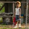 FILE - This publicity photo released by Fox Searchlight Pictures shows Quvenzhane Wallis portraying Hushpuppy in a scene from the film,