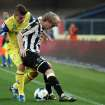 Udinese's Dusan Basta, right, of Serbia is challenged by Chievo forward Alberto Paloschi during a Serie A soccer match at Bentegodi stadium in Verona, Italy, Saturday, Sept. 21, 2013. (AP Photo/Felice Calabro')