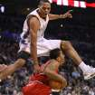 OKLAHOMA CITY THUNDER / CHICAGO BULLS / NBA BASKETBALL  Oklahoma City Thunder guard Russell Westbrook leaps over Chicago's Derrick Rose during the Thunder - Bulls game January 27, 2010 in the Ford Center in Oklahoma City.    BY HUGH SCOTT, THE OKLAHOMAN ORG XMIT: KOD