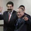 Venezuela's Vice President Nicolas Maduro, left, and National Assembly President Diosdado Cabello greet the media as they arrive to the Supreme Court for a special session marking the start of the judicial year in Caracas, Venezuela, Monday, Jan. 21, 2013. Maduro said Sunday he's optimistic that President Hugo Chavez will soon return to Venezuela following cancer-related surgery in Cuba. (AP Photo/Fernando Llano)