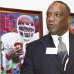 UNIVERSITY OF OKLAHOMA / OU: Former Oklahoma Heisman Trophy winner Billy Sims talks with the media in front of his portrait before induction ceremonies at the Texas Sports Hall of Fame Thursday Feb. 15, 2007, in Waco, Texas. Sims was inducted along with Cynthia Cooper, Roosevelt Leaks, Warren Moon, Rafer Johnson, Jerry Jones, Don Perkins, and DeLoss Dodds. (AP Photo/Waco Tribune-Herald, Duane A. Laverty) ORG XMIT: TXWAC104