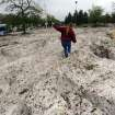 Nicole Carpe tries to walk through the deep pile of hail at the southwest corner of The Citadel mall Thursday, June 7, 2012, after a hail and rain storm hit Colorado Springs, Colo., Wednesday night. (AP Photo/ The Gazette, Christian Murdock)