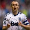 Vancouver Whitecaps' Kenny Miller, of Scotland, celebrates his goal against the Seattle Sounders during the first half of an MLS soccer  match in Vancouver, British Columbia, on Saturday, July 6, 2013. (AP Photo/The Canadian Press, Darryl Dyck)