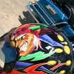 In the biker's world custom artwork isn't limited to motorcycles, but extends to the safety helmets that many bikers wear. This joker's helmet is just an example of the artwork that could be seen during the J. D. McCarty Center Poker Run held Saturday, July 22. The poker run was a 180-mile tour of south central Oklahoma that started at the McCarty Center and ended at the Santa Fe Cattle Company in Norman.  Community Photo By:  Greg Gaston  Submitted By:  Greg,