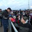 Oklahoma pro bass angler Edwin Evers signs an autograph at the start of last year's Bassmaster Classic on the Red River in Bossier City, La. Evers is one of three Oklahoma pros who qualified for the 2013 Bassmaster Classic next month on Grand Lake. Tommy Biffle of Wagoner and Jason Christie of Park Hill also will be fishing in the tournament which will award $500,000 to the winner. AP ARCHIVE PHOTO