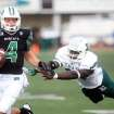 Ohio University quarterback Tyler Tettleton tries to evade an Eastern Michigan defender in the second quarter of an NCAA college football game Saturday, Oct. 19, 2013, in Ypsilanti, Mich. Ohio won 56-28. AP Photo/The Ann Arbor News, Brianne Bowen