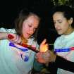 UCO sophomore Tiffany Palmer and freshman Leah Buller light a candle for the luminary ceremony Friday April 25, at Plunkett Park. (photo by Chanel Henry).  Community Photo By:  Chanel Henry  Submitted By:  chanel, edmond