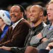 New York Yankees' Derek Jeter, third from right, attends the New York Knicks against the Minnesota Timberwolves NBA basketball game with his father, Charles, third from left, on Sunday, Dec., 23, 2012, at Madison Square Garden in New York. (AP Photo/Kathy Kmonicek)