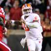 Clemson's Tajh Boyd (10) looks to pass the ball during the first half of an NCAA college football game against North Carolina State in Raleigh, N.C., Thursday, Sept. 19, 2013. (AP Photo/Karl B DeBlaker)