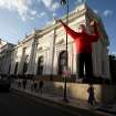 FILE - In this Feb. 18, 2013 file photo, a giant inflatable doll depicting Venezuela's President Hugo Chavez is displayed in front of Venezuela's National Assembly in Caracas, Venezuela. After more than eight years covering Venezuela, AP reporter Ian James finishes his assignment believing Venezuela's many long-term challenges, such as crime, corruption, a troubled economy and bitter political divisions, can seem as vast as the sea of crude oil that Venezuela sits atop. And with Chavez battling cancer, the country could be headed for big political shifts and possible turmoil. But James takes the view that the country's problems can be solved. (AP Photo/Fernando Llano, File)