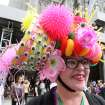 Wearing a hat made with plastic puppet eyes, Leslie Lowe, of New York, poses for photographs as she takes part in the Easter Parade along New York's Fifth Avenue Sunday, April 24, 2011. (AP Photo/Tina Fineberg)