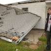 TORNADO DAMAGE, HOUSE: Joe Don Rooney, with the country music group Rascal Flatts outside of his boyhood home in Picher, Okla. which was destroyed in the tornado Saturday evening.   BY GARY CROW, FOR THE OKLAHOMAN ORG XMIT: KOD