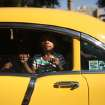 Samantha Sykes, 3, hangs out the window of a 1955 Chevy during the Black Heritage Society's 36th Annual Original Martin Luther King Jr. Parade in downtown Houston, Monday, Jan. 20, 2014. (AP Photo/Houston Chronicle, Johnny Hanson)
