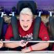 University of Oklahoma students Courtney Cormier, Hillary Elmore, and Caitlyn Tait, from left to right) react as they ride the Space Loop at the 2009 Oklahoma State Fair at State Fair Park in Oklahoma City on Sunday, Sept. 27, 2009.  By John Clanton, The Oklahoman