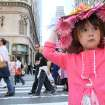 **CORRECTS SPELLING** Julia Scotti, 4, of Fairlawn, N.J., right, adjusts her hat as she and her mother Regina Scotti, left, take part in the Easter Parade along New York's Fifth Avenue Sunday April 24, 2011. (AP Photo/Tina Fineberg)