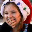 Hannah Alexander, 10, laughs and covers her mouth when marshmallow oozes out of it after she bit into a s'mores snack.  Alexander is a Junior Girl Scout in Troop 625. Edmond Girl Scouts made S'mores, a popular winter snack,  on a corner in downtown Edmond Saturday, Dec. 17, 2011, as a fundraiser for their troop.   The Scouts, with Troop 625, used a griddle as their heat source to melt marshmallows on a skewer and sandwich it with a square of chocolate between two graham crackers.  Money raised will help girls who want to join Scouts but require some financial assistance with the activity fees and various other costs involved in Scouting.  This activity was part of a series of  Downtown Edmond' Christmas celebrations.   Photo by Jim Beckel, The Oklahoman