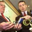 ADVANCE FOR MONDAY JAN. 28 AND THEREAFTER - FILE - In this Tuesday Jan. 6, 2004 file photo, New Jersey Gov. James E. McGreevey, right, points to the handle of a
