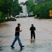 Two men walk into the rising water, west of Sooner Road on Hefner. Cars are stranded on a bridge in background. Firefighters made several swift-water rescues in this area Monday. Torrential rain caused flooding in Oklahoma City, Monday, June 14, 2010.     by Jim Beckel, The Oklahoman