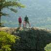 Hawksbill Crag, also known as Whitaker Point, is one of the most-photographed spots in Arkansas. Posing at the midpoint of the three-mile round trip hike to the crag are Matt and Anna Bell and their daughter, Megan. Matt Bell is director of sports and events for the Harrison Convention and Visitors Bureau. Photo by Timothy Burk  Timothy Burk