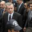 In this Wednesday, May 14, 2014 photo, Yusuf Yerkel, right, advisor to Turkish Prime Minister Recep Tayyip Erdogan, stands behind Erdogan during his visit in Soma, Turkey. Yerkel  was identified by Turkish media as the advisor who kicked a protester who was held by special forces police members during Erdogan's visit to  Soma, Turkey. Erdogan was visiting the western Turkish mining town of Soma after Turkey's worst mining accident . (AP Photo/Emrah Gurel)