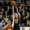 Iowa center Morgan Johnson (12) puts up a shot over Iowa State center Anna Prins (55) during the first half an NCAA college basketball game Thursday, Dec. 6, 2012 at Carver-Hawkeye Arena in Iowa City, Iowa.  (AP Photo/The Gazette,Brian Ray)