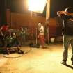 """Producer/director Kyle Roberts, center, works with the crew during a night shoot for the Oklahoma-made coming-of-age superhero movie """"The Posthuman Project"""" in Oklahoma City's Automobile Alley."""