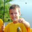 Tommy Wolf shown in a 2008 photo provided by his Cub Scout pack. Tommy, 9, died Monday after an incident at his Nichols Hills home, 1715 Elmhurst Ave. His father, Stephen Wolf, 51, was jailed on a murder complaint in connection with his death. Photo provided.