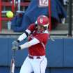 OU's Jessica Shults hits a fly ball during the University of Oklahoma - Louisiana State University game at