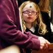 Maddisun Wagoner, 5, looks up to her grandmother on Wednesday, Feb. 22, 2012 during mass at St. Pius Catholic Church in Coeur d'Alene, Idaho. Ash Wednesday marks the beginning of the Lent season which lasts 40 days. (AP Photo/Coeur d'Alene Press, Shawn Gust)